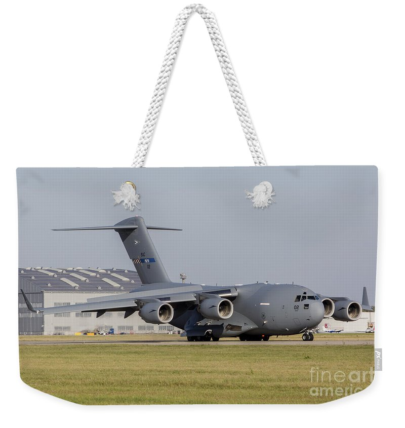 Ostrava Weekender Tote Bag featuring the photograph A C-17 Globemaster Strategic Transport by Timm Ziegenthaler
