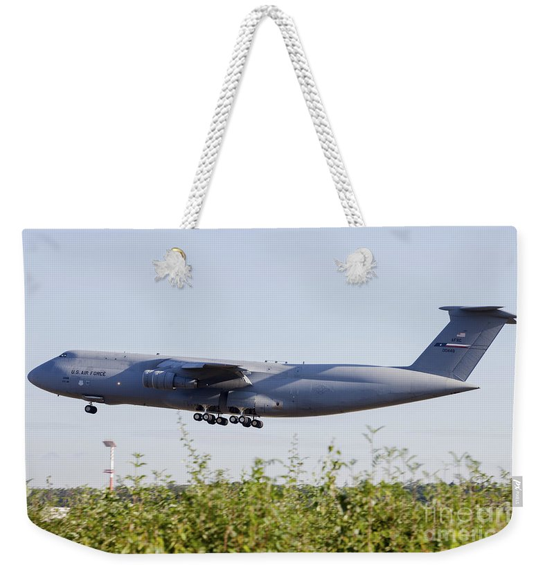 Ramstein Air Base Weekender Tote Bag featuring the photograph A C-5a Galaxy Of The U.s. Air Force by Timm Ziegenthaler