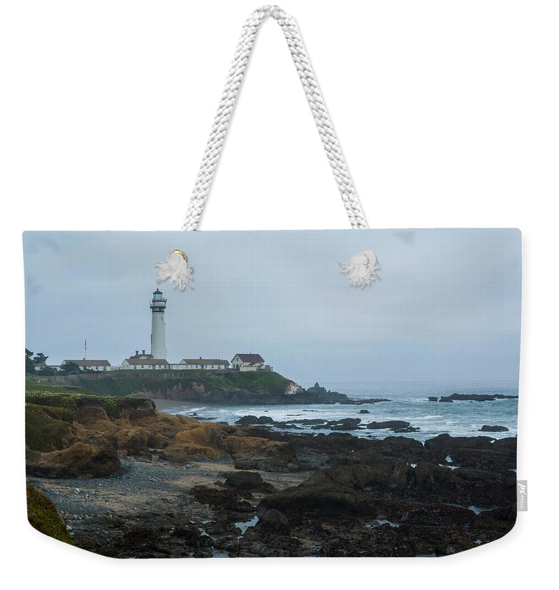 Pidgeon Point Lighthouse Weekender Tote Bag featuring the photograph A Cloudy Day At Pigeon Point by Bryant Coffey