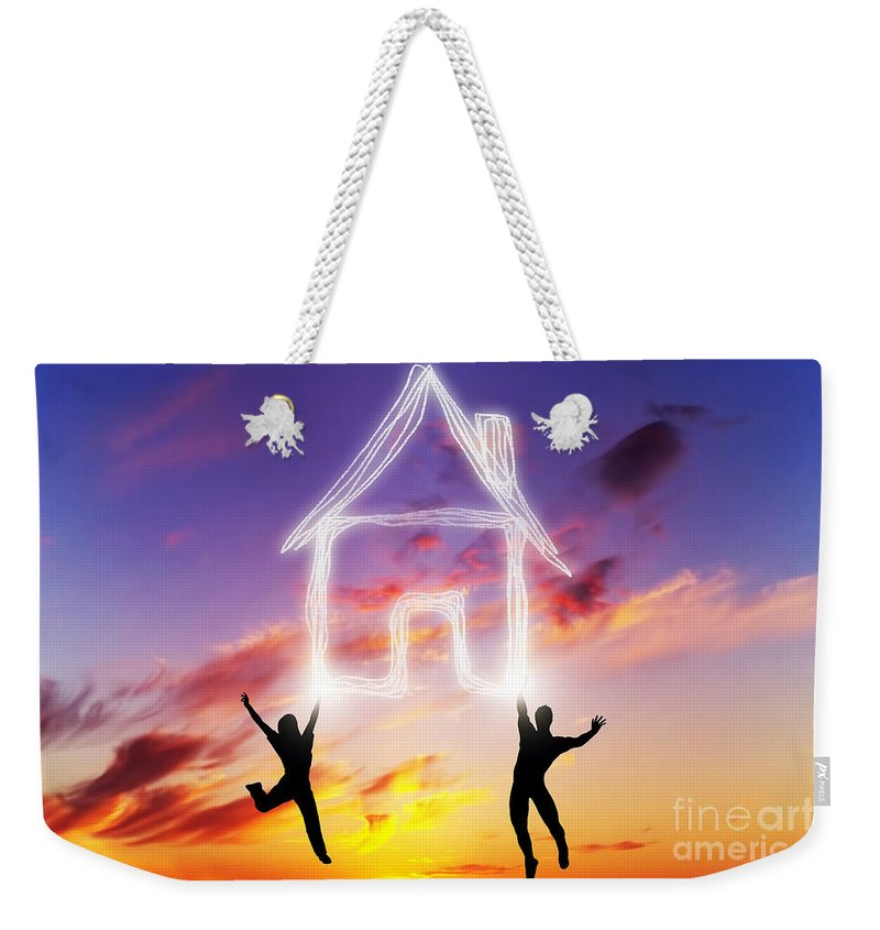 House Weekender Tote Bag featuring the photograph A Couple Jump And Make A House Symbol Of Light by Michal Bednarek