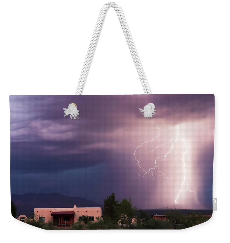 Lightning Weekender Tote Bag featuring the photograph A Dance Of Lightning In The Foothills by Derrick Neill