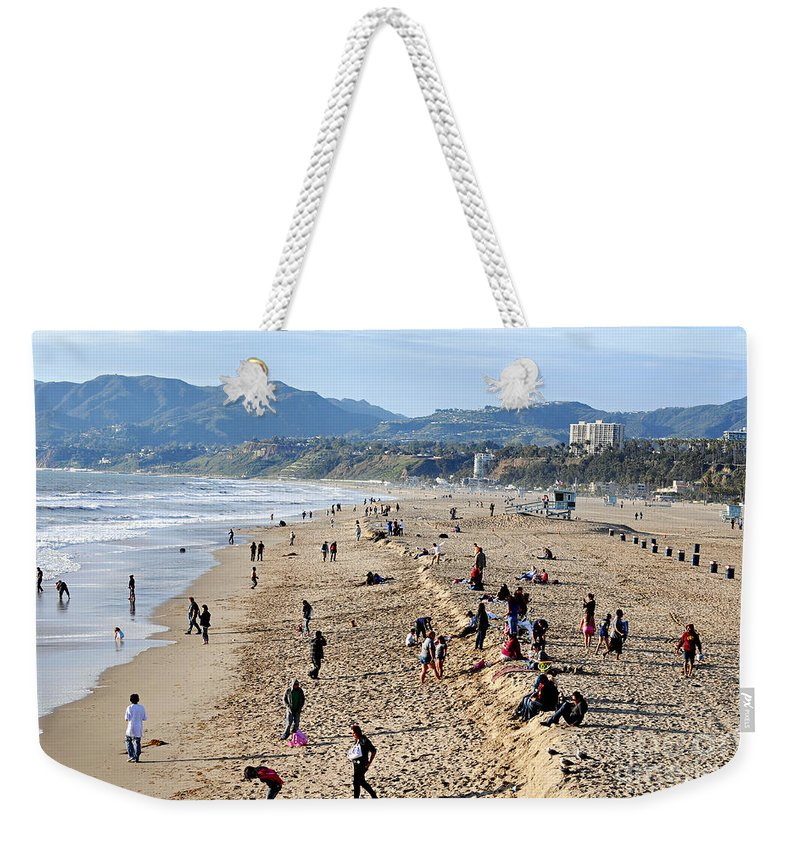 Clay Weekender Tote Bag featuring the photograph A Day At The Beach In Santa Monica by Clayton Bruster