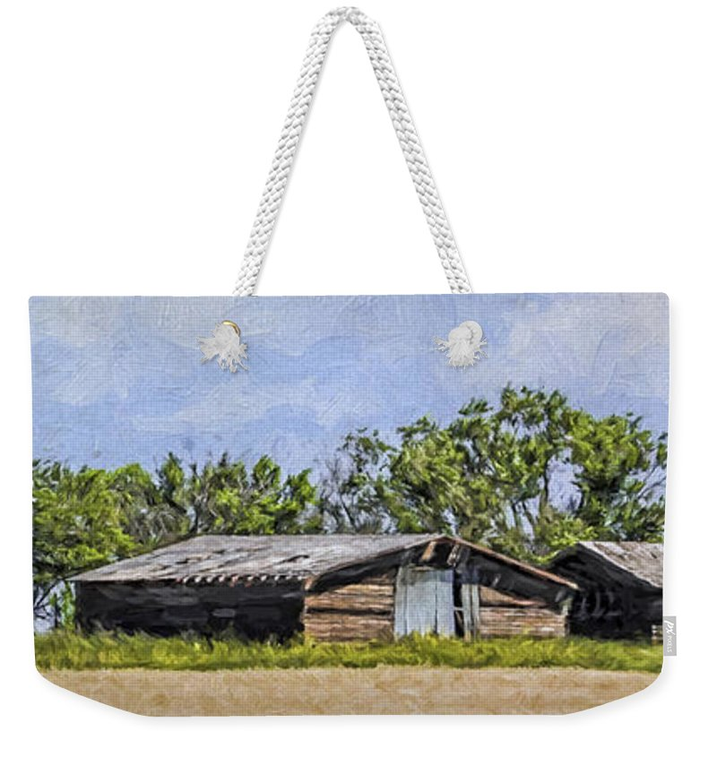 A Deserted Farm Weekender Tote Bag featuring the photograph A Deserted Farm by Priscilla Burgers