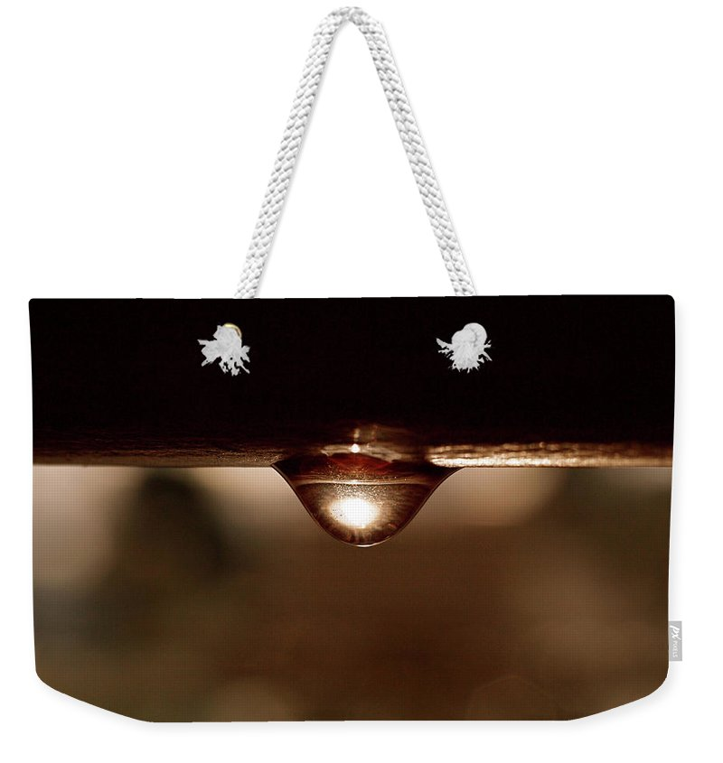 Water Weekender Tote Bag featuring the photograph A Drop of Sun by Rona Black
