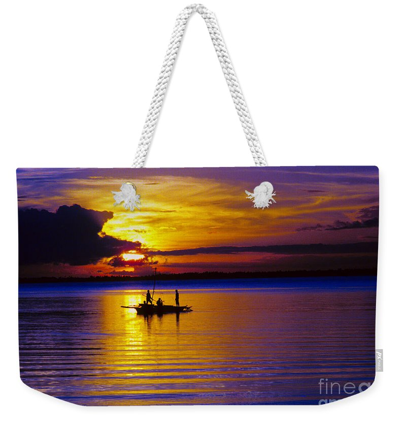 Sunset Weekender Tote Bag featuring the photograph A Fisherman's Sunset by James BO Insogna