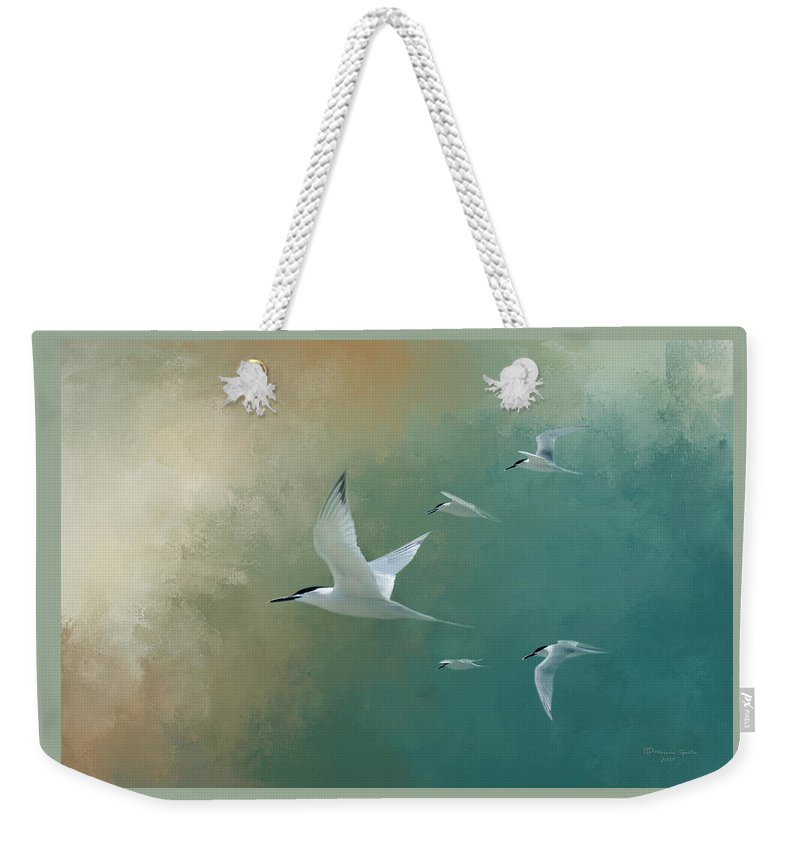 Egmont Key Weekender Tote Bag featuring the photograph A Flight Of Terns by Marvin Spates