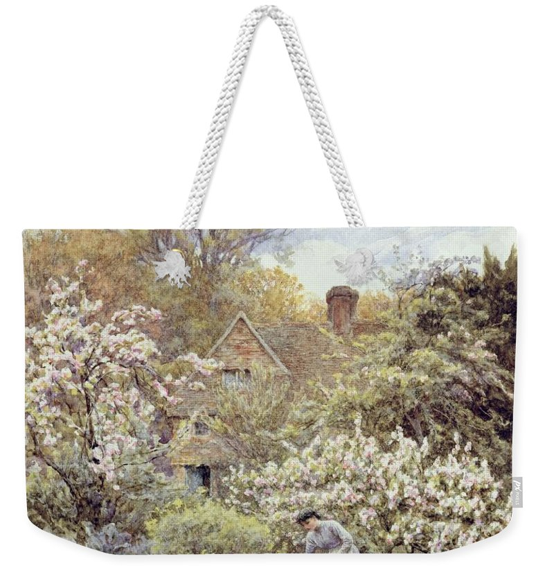 Cottage; Female; Gardener; Rural Scene; Country; Countryside; Home; Path; Wildflowers; Roses; Tulips; Irises; Magnolia; Springtime; Season; Picturesque; Idyllic; House; Female Weekender Tote Bag featuring the painting A Garden In Spring by Helen Allingham