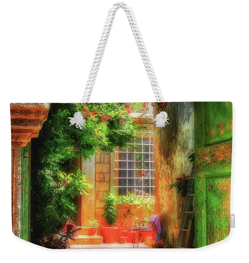 Doorway Weekender Tote Bag featuring the photograph A Glimpse by Lois Bryan