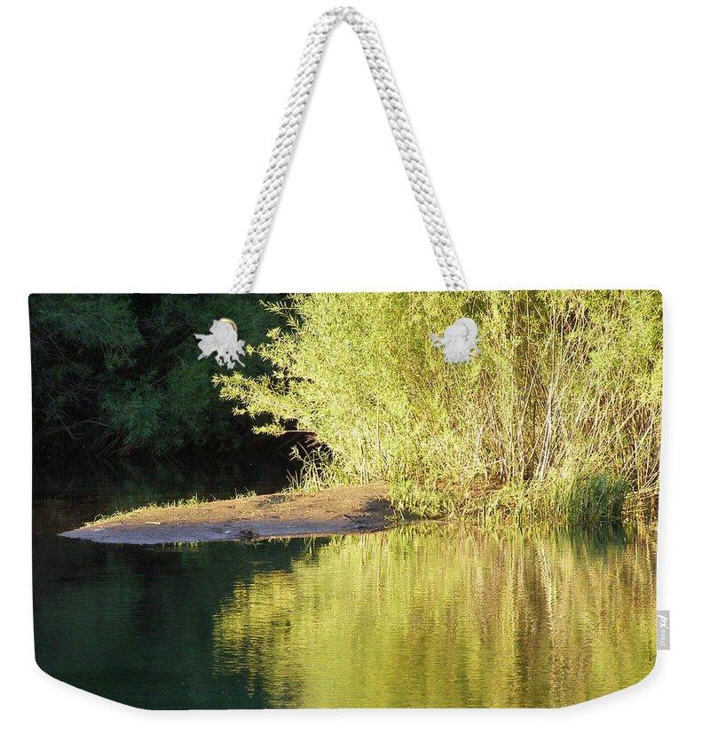 Water Weekender Tote Bag featuring the photograph A Golden Reflection by DeeLon Merritt