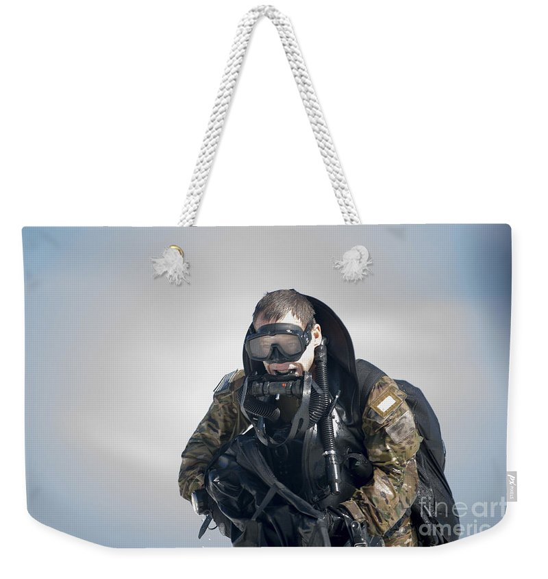 Horizontal Weekender Tote Bag featuring the photograph A Green Beret Emerges Onto Okaloosa by Stocktrek Images