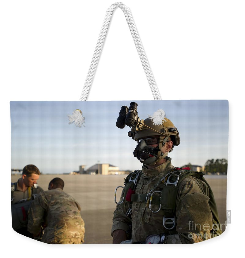 Soldier Weekender Tote Bag featuring the photograph A Green Beret Waits To Have His Gear by Stocktrek Images