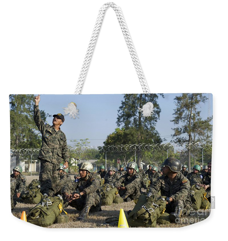 Soldier Weekender Tote Bag featuring the photograph A Honduran Jumpmaster Explains Actions by Stocktrek Images