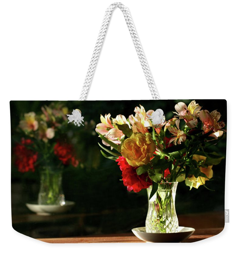 Still Life Weekender Tote Bag featuring the photograph A Light Through Yonder Window Breaks by Marion Cullen