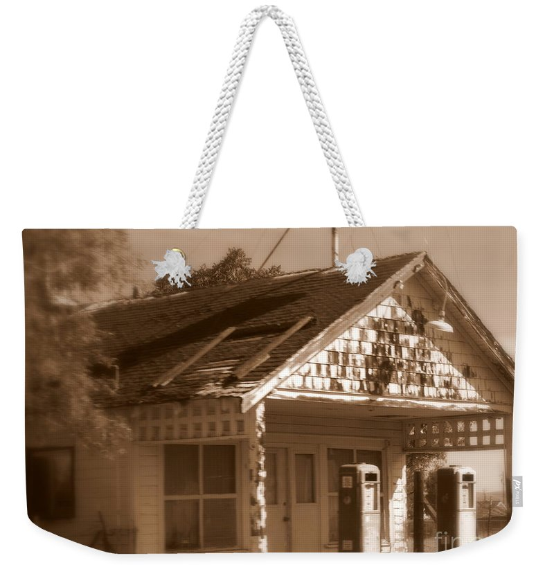 Old Building Weekender Tote Bag featuring the photograph A Little Weathered Gas Station by Carol Groenen