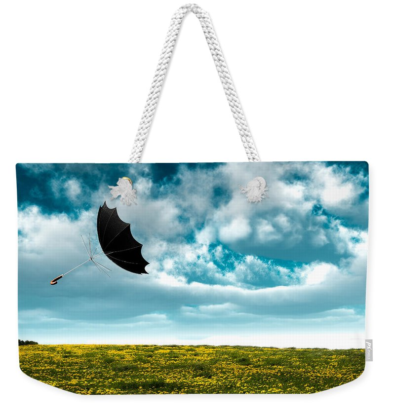 Umbrella Weekender Tote Bag featuring the photograph A Little Windy by Bob Orsillo
