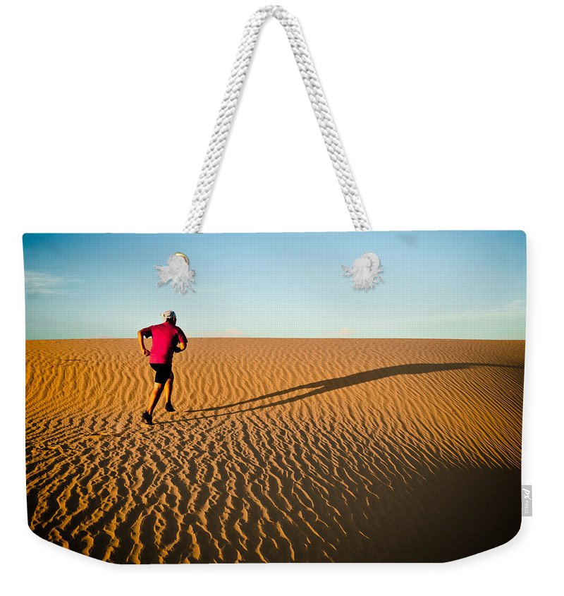 Running Weekender Tote Bag featuring the photograph A Long Desert Run by Scott Sawyer