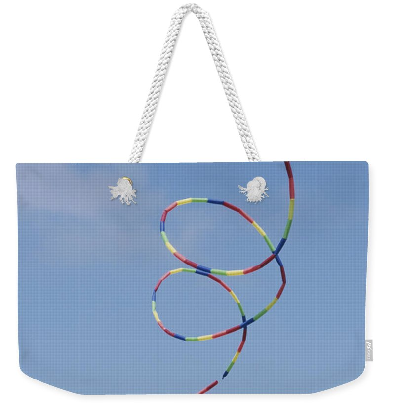 Outdoors Weekender Tote Bag featuring the photograph A Long-tailed Kite Soars by Stephen Sharnoff