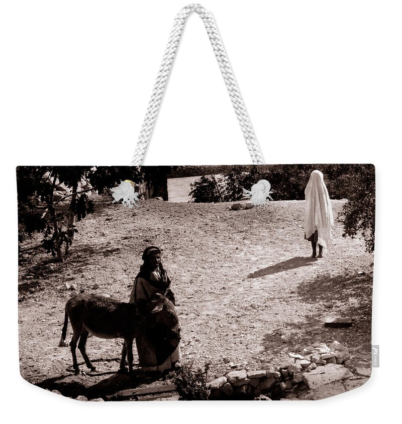 Woman Weekender Tote Bag featuring the photograph A Man With His Bride 1900s by Munir Alawi