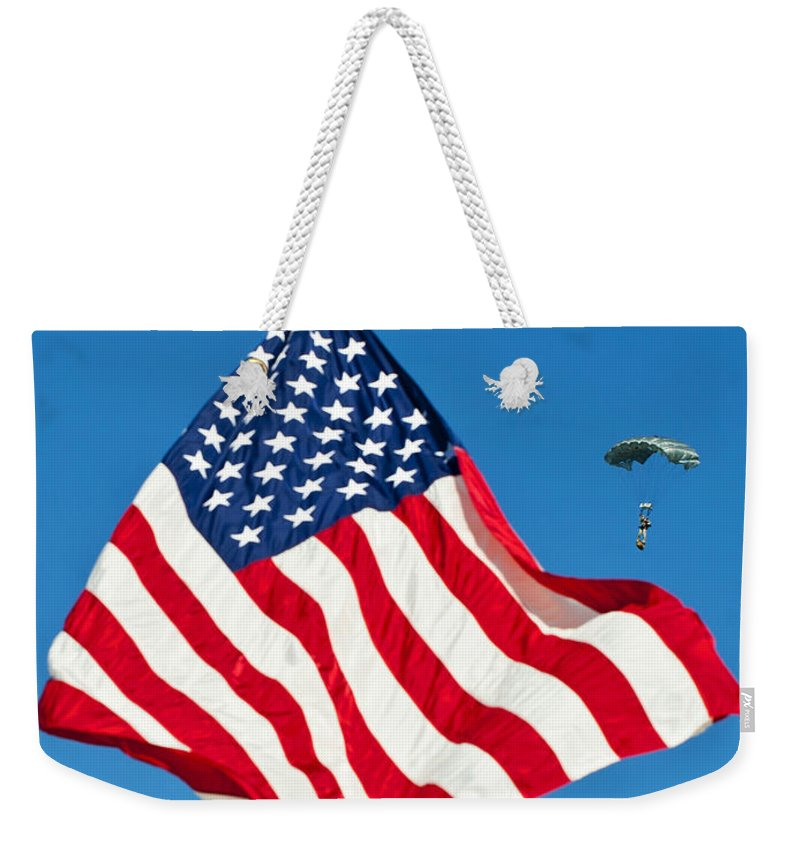 Army Weekender Tote Bag featuring the photograph A Member Of The Army's Black Daggers by Stocktrek Images