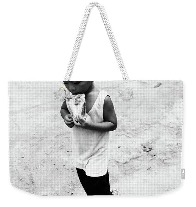 Mati Weekender Tote Bag featuring the photograph A Mere Bite by Jez C Self