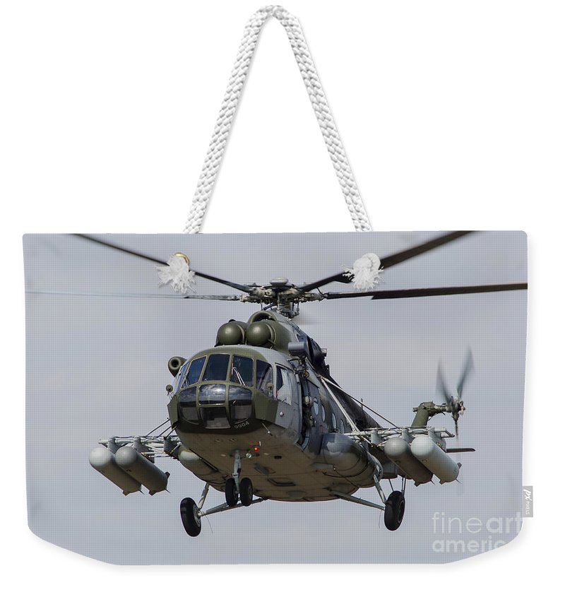 Hradec Kralove Weekender Tote Bag featuring the photograph A Mil Mi-17 Helicopter Of The Czech Air by Timm Ziegenthaler