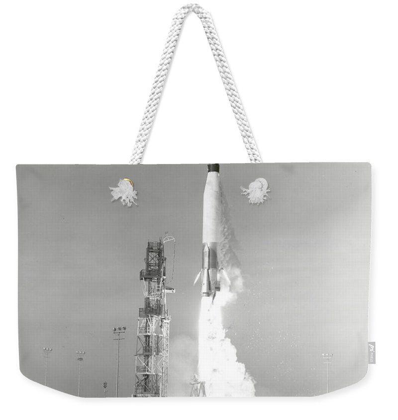 Mercury Weekender Tote Bag featuring the photograph A Nasa Project Mercury Spacecraft by Stocktrek Images