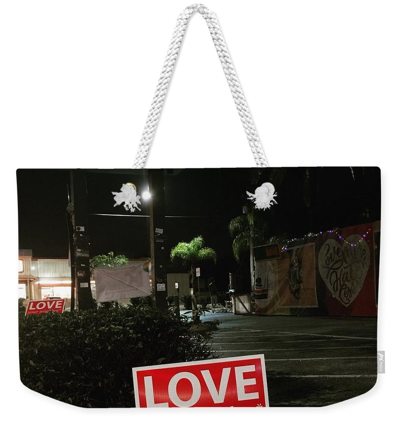 Pluse Weekender Tote Bag featuring the photograph A Night Walk In Orlando by Chris Hood