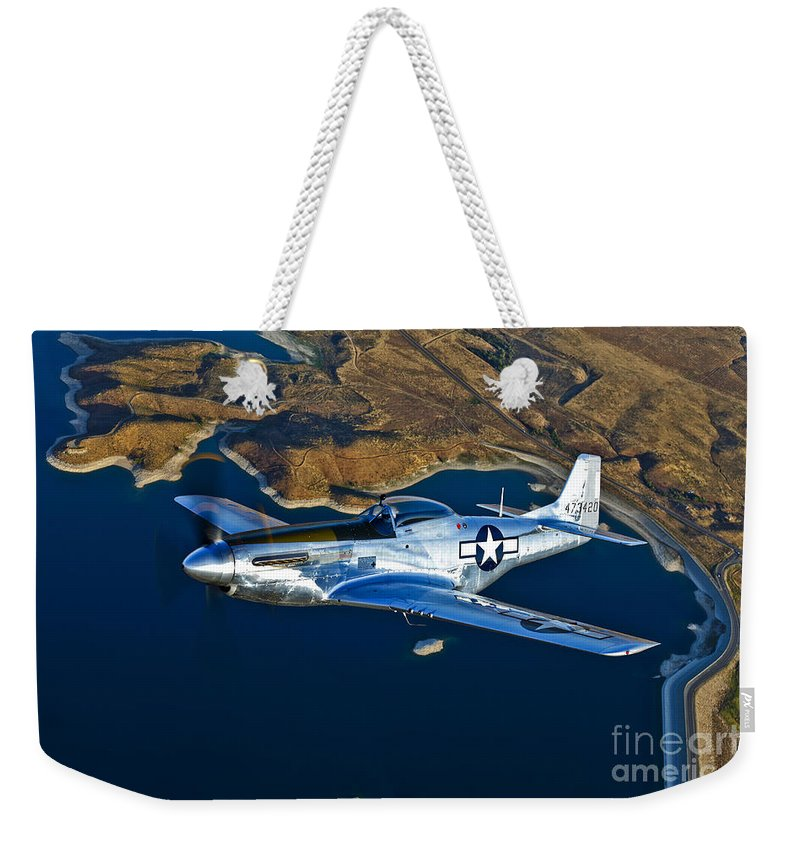 Horizontal Weekender Tote Bag featuring the photograph A North American P-51d Mustang Flying by Scott Germain