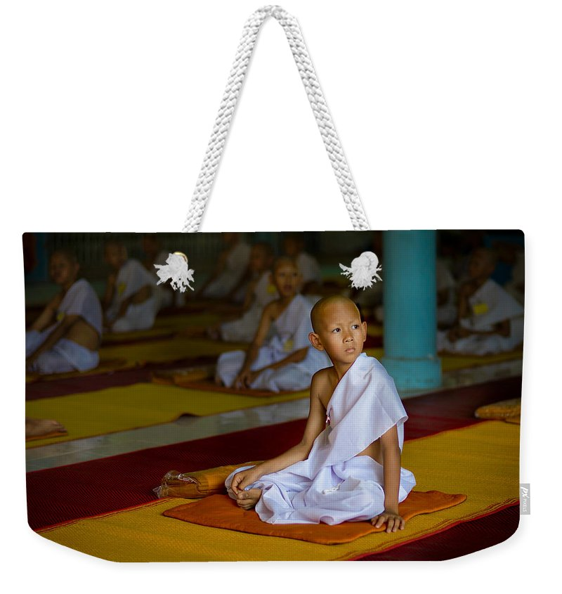 Thailand Weekender Tote Bag featuring the photograph A Novice Monk In Rural Thailand by Lee Craker