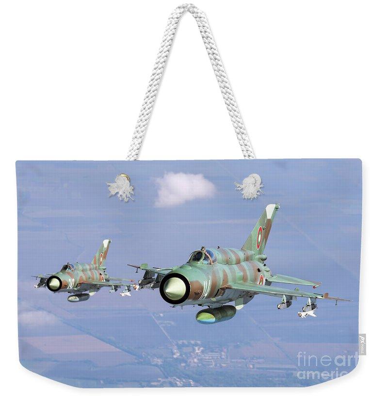 Bulgaria Weekender Tote Bag featuring the photograph A Pair Of Bulgarian Air Force Mig-21bis by Daniele Faccioli