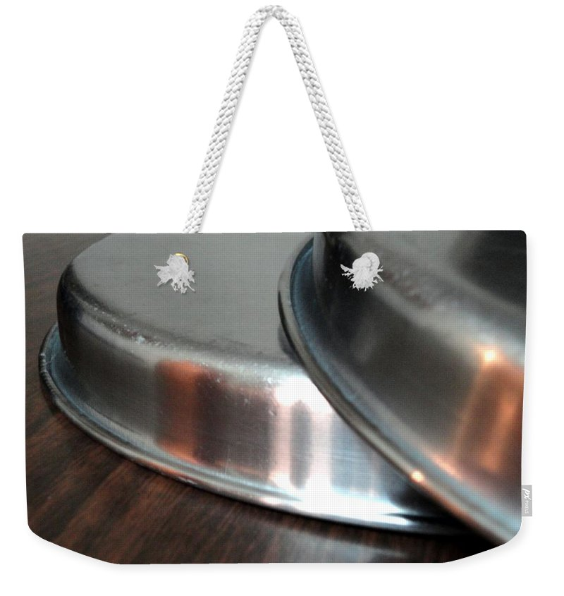 Pair Weekender Tote Bag featuring the photograph A Pair Of Steel Plates by Usha Shantharam