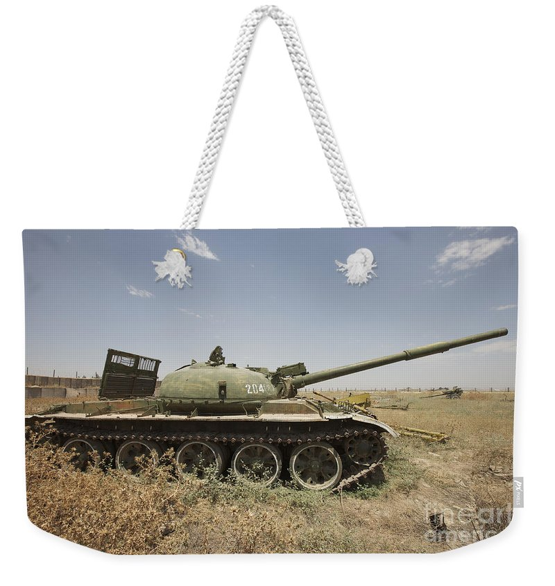 Turret Weekender Tote Bag featuring the photograph A Russian T-62 Main Battle Tank Rests by Terry Moore