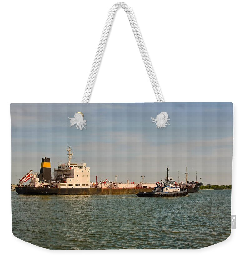 Tanker Ship Weekender Tote Bag featuring the photograph A Ships Guide by Robert Brown