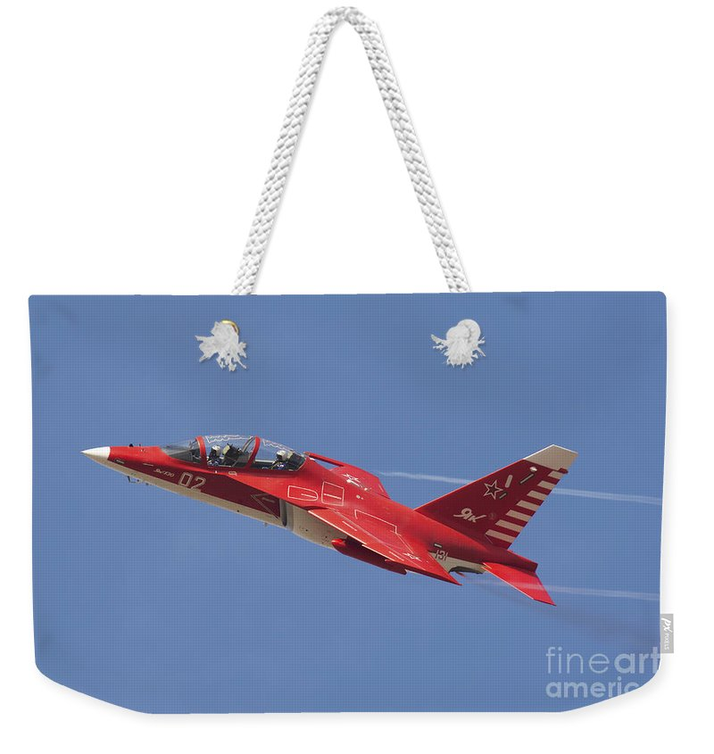 Horizontal Weekender Tote Bag featuring the photograph A Special Painted Yak-130 Performing by Daniele Faccioli