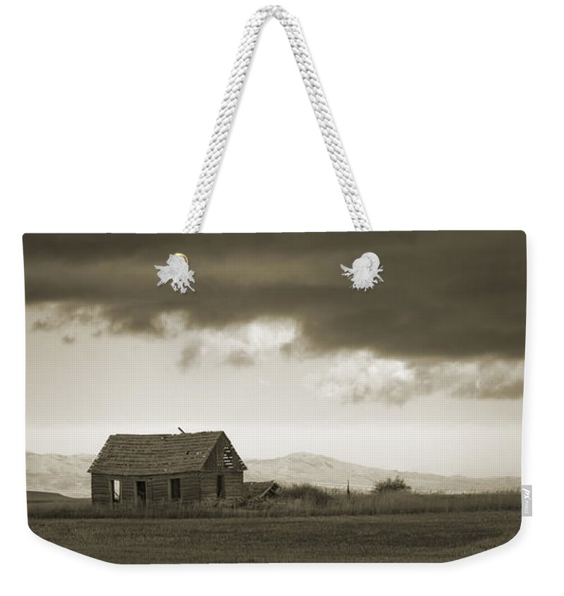 A Storm Looms Weekender Tote Bag featuring the photograph A Storm Looms by Priscilla Burgers