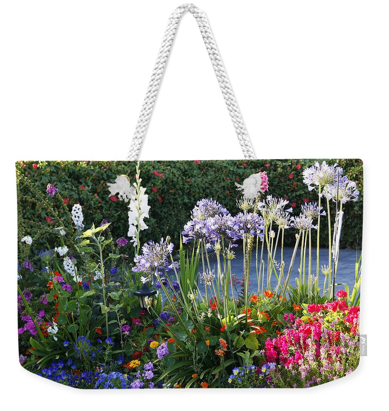 Summer Weekender Tote Bag featuring the photograph A Summer Garden by Marilyn Hunt