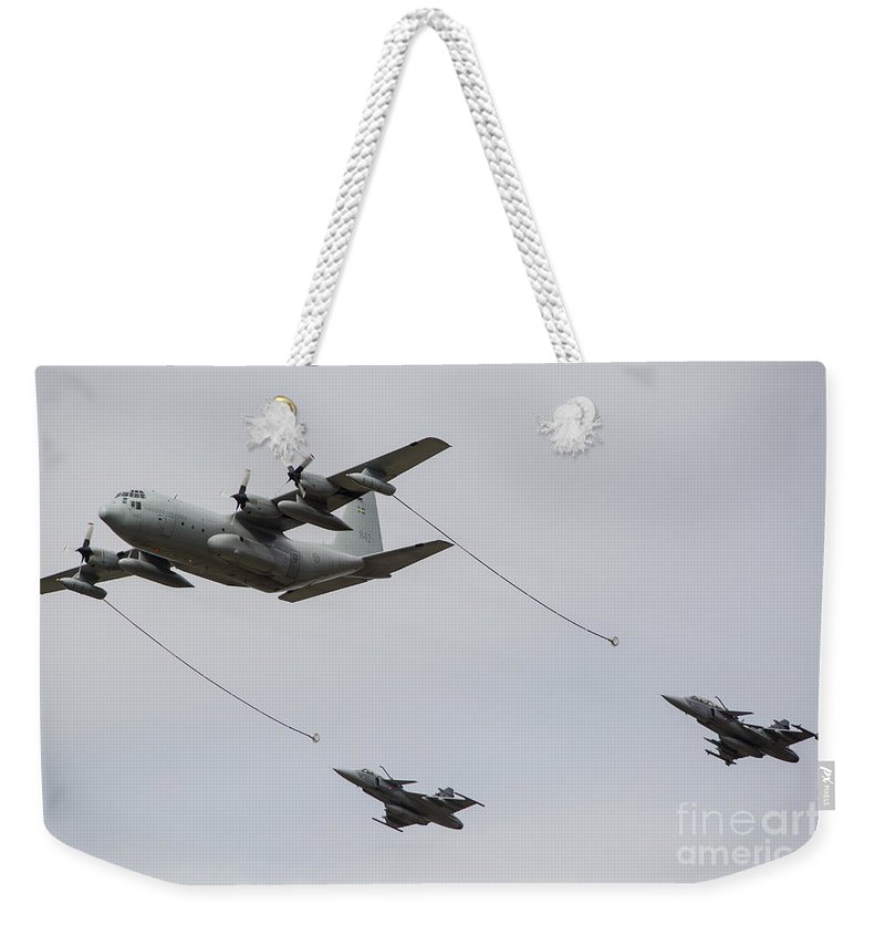 Ostrava Weekender Tote Bag featuring the photograph A Swedish Air Force C-130e Hercules by Timm Ziegenthaler