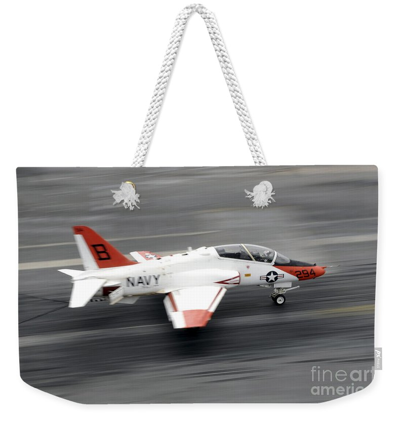 Flight Deck Weekender Tote Bag featuring the photograph A T-45c Goshawk Training Aircraft Makes by Stocktrek Images