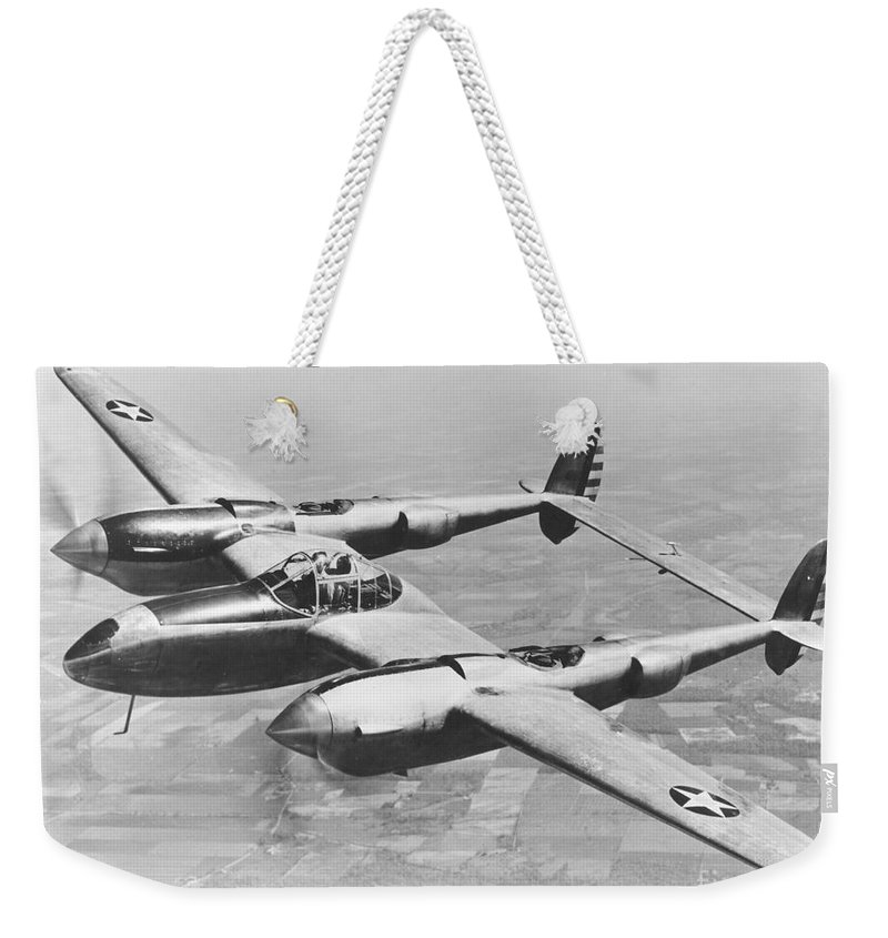 1940s Style Weekender Tote Bag featuring the photograph A Test Flight Of The Yp-38 Service Test by Stocktrek Images