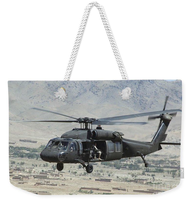 Horizontal Weekender Tote Bag featuring the photograph A Uh-60 Blackhawk Helicopter by Stocktrek Images