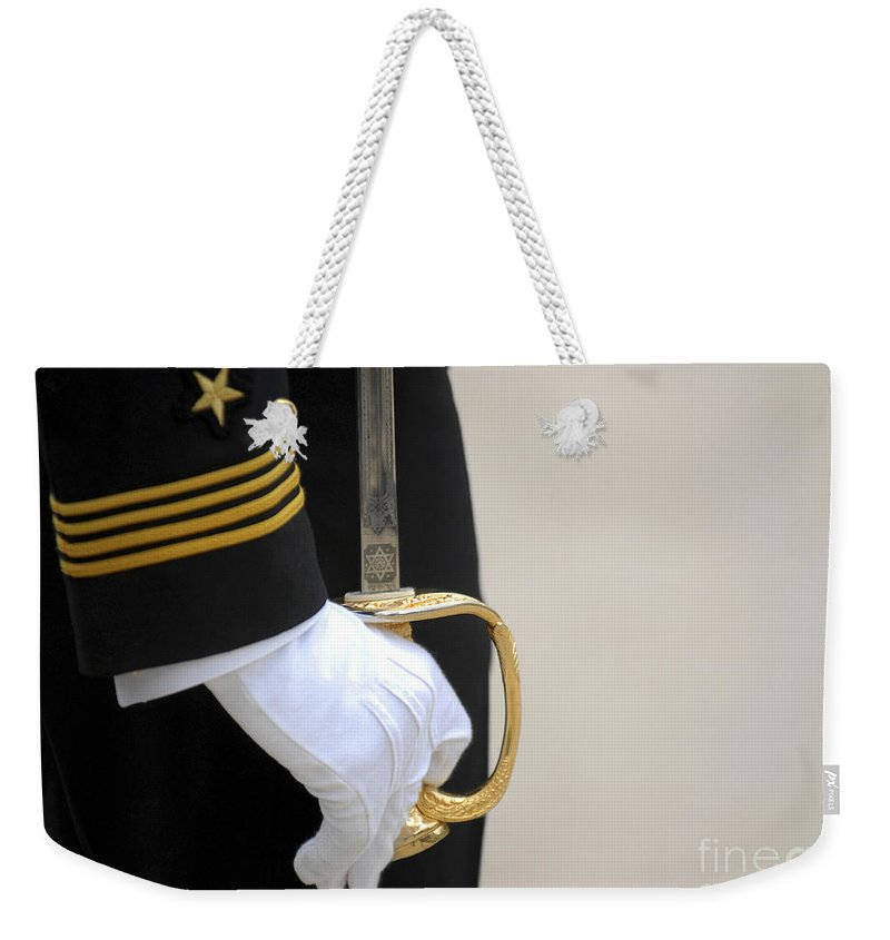 Naval Academy Weekender Tote Bag featuring the photograph A U.s. Naval Academy Midshipman Stands by Stocktrek Images
