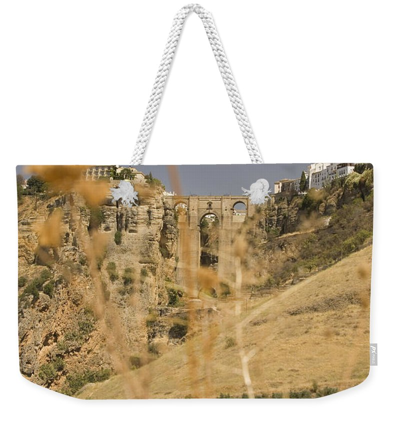 Tajo Weekender Tote Bag featuring the photograph A View Of The Tajo De Ronda And Puente Nuevo Bridge Serrania De Ronda Andalucia Spain by Mal Bray
