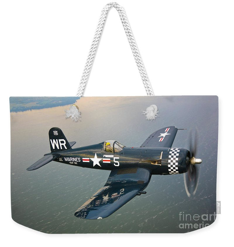 Transportation Weekender Tote Bag featuring the photograph A Vought F4u-5 Corsair In Flight by Scott Germain
