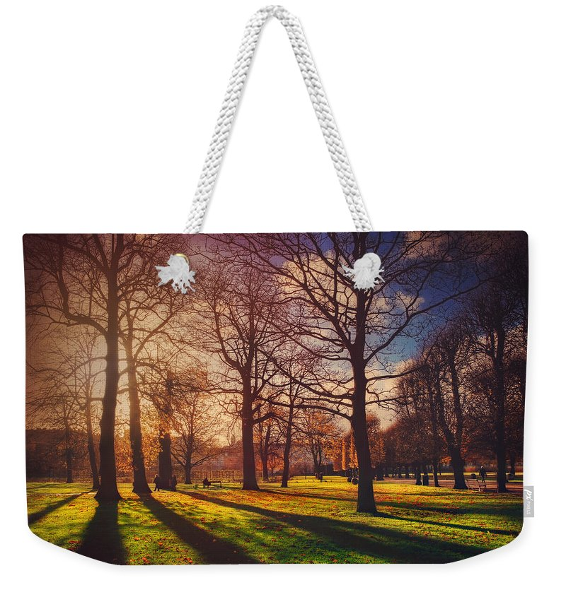 Copenhagen Weekender Tote Bag featuring the photograph A Walk In The Park by Carol Japp