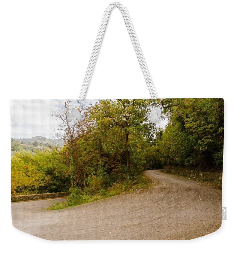 Fall Weekender Tote Bag featuring the photograph A Winding Road 2 by Andrea Mazzocchetti