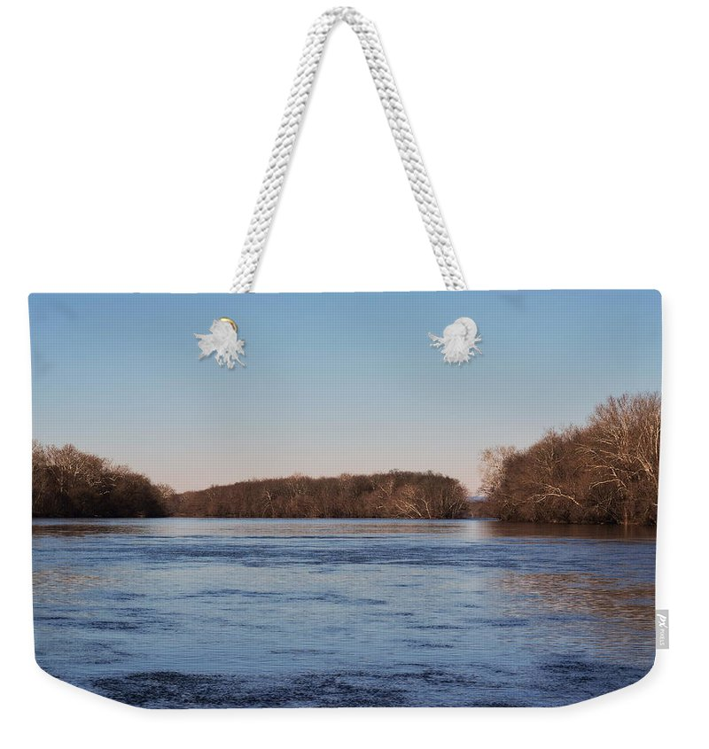 River Weekender Tote Bag featuring the photograph A Windswept River In March by Gregory Strong