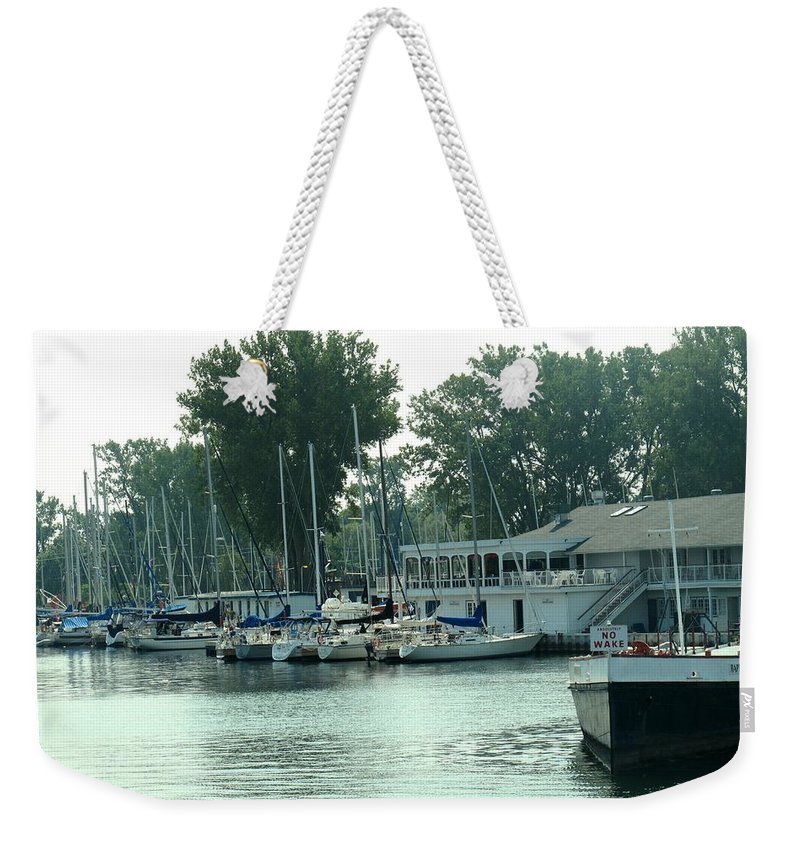 Toronto Weekender Tote Bag featuring the photograph A Yacht Club by Ian MacDonald