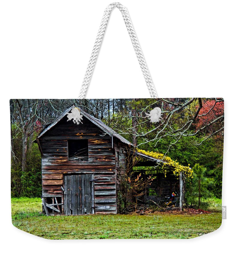 Barn Weekender Tote Bag featuring the photograph A Yellow Cover by Christopher Holmes