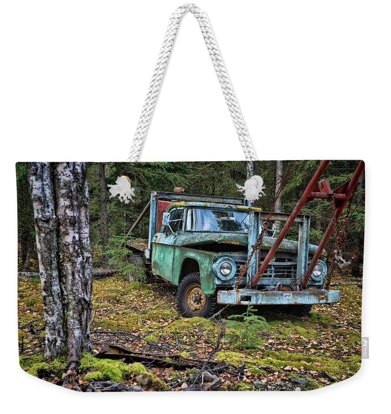 Dodge Weekender Tote Bag featuring the photograph Abandoned Alaskan Logging Truck by Nick Gray