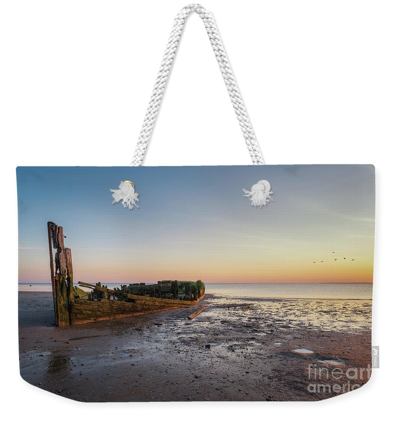 Shipwreck Sunset Weekender Tote Bag featuring the photograph Abandoned Boat by Michael Ver Sprill